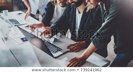 Professionals Working on Laptops, Business Target Stock photo © robuart