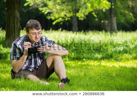Yeşil giyim gözlük ayarlamak erkek Stok fotoğraf © toyotoyo