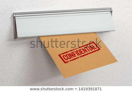 A letter stamped confidential in a mail slot Stock photo © Zerbor