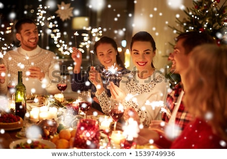 happy friends celebrating christmas at home feast Stock photo © dolgachov