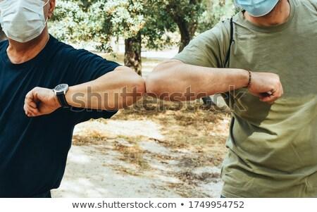Gondoskodó egyéb idős férfi nő kéz a kézben Stock fotó © pressmaster