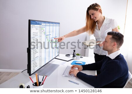 Businesswoman Pointing At Screen While Analyzing Gantt Chart Stock photo © AndreyPopov