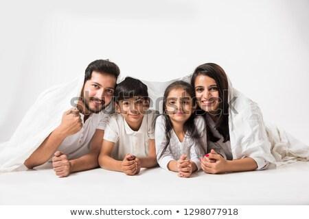 Boldog mosolyog kaukázusi család ágy szórakozás Stock fotó © dashapetrenko