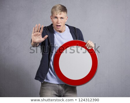 Man showing universal forbidden sign. Stock photo © lichtmeister