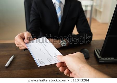 Biznesmen ręce czek inny osoby biuro Zdjęcia stock © AndreyPopov