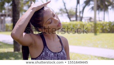 Tired Asian woman rubbing head with closed eyes in park Stock photo © dash