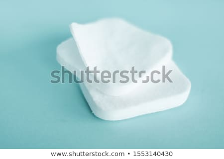 Organic cotton pads on mint background, cosmetics and make-up re Stock photo © Anneleven