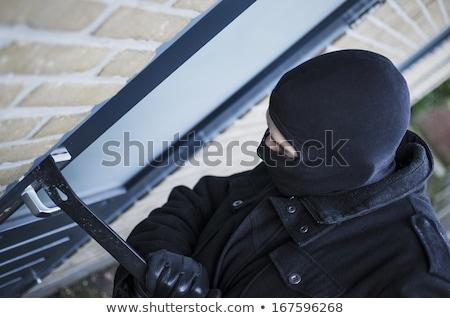 Burglar Breaking Into House By Forcing Door With Crowbar Stock photo © HighwayStarz