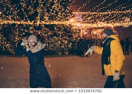 People Playing Snowball Fight in Evening City Stock photo © robuart