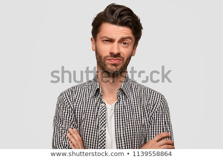 Portrait of hesitant bearded male with doubtful expression, shru Stock photo © vkstudio