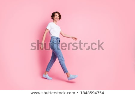 Cheerful young woman wearing summer clothes walking Stock photo © deandrobot