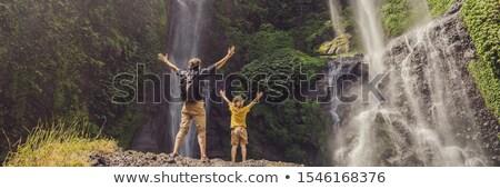 Dad and son at the Sekumpul waterfalls in jungles on Bali island, Indonesia. Bali Travel Concept BAN Stock photo © galitskaya