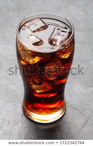 Class of cola with ice cubes Stock photo © karandaev