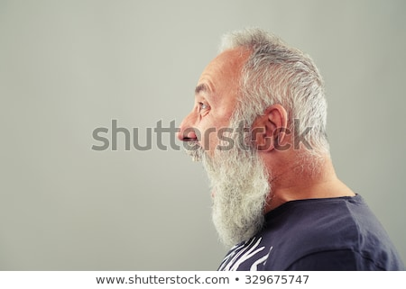Elderly grey-haired bearded man screaming. Stock photo © deandrobot