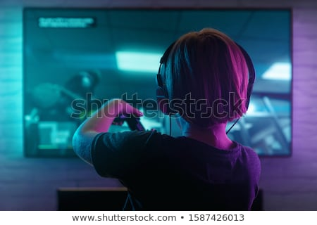 Boy using console playing games Stock photo © lovleah