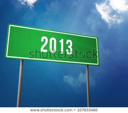 2012 arrow road sign on sky background. Stock photo © borysshevchuk