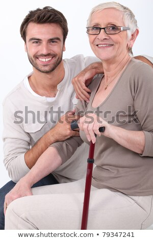 Young man crouching by elderly woman Stock photo © photography33