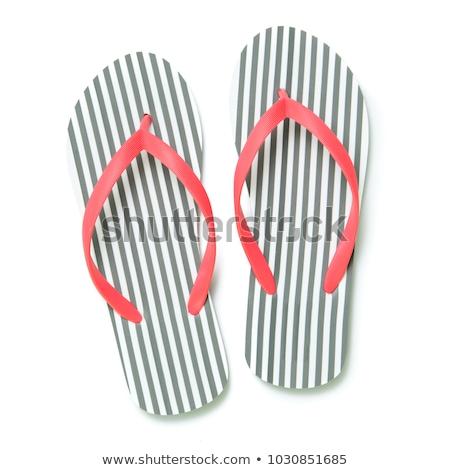 Female feet with flip-flops, isolated on white background Stock photo © Nobilior