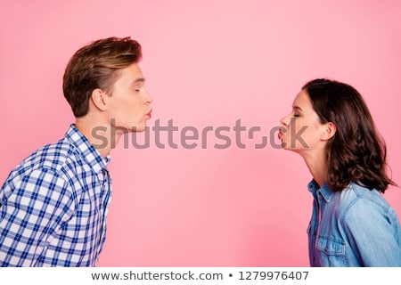 romantic couple kissing each other stock photo © stockyimages