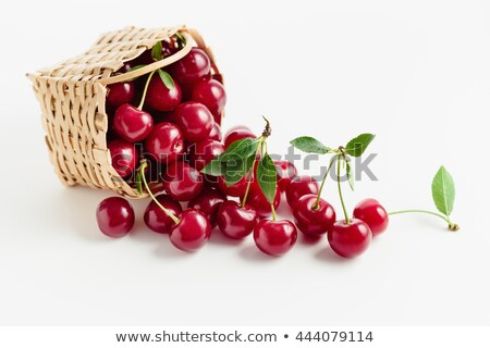 Cherries with cherry tart in the background stock photo © elly_l