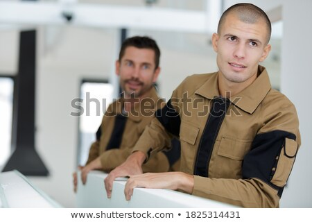 two craftsmen carrying materials Stock photo © photography33