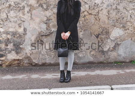 Dark model wearing a leather coat and boots in an old fashion main entrance of old house Stock photo © carlodapino