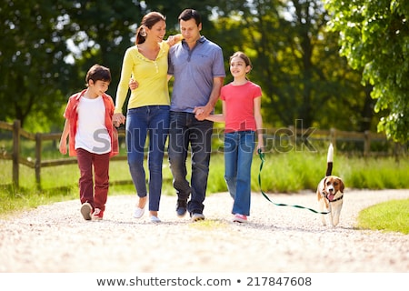 Happy family walking on the path Stock photo © emese73
