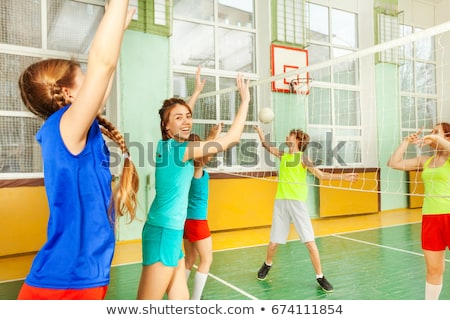 Teenage girl catching a volley ball. Stock photo © DonLand