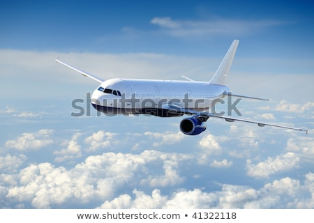 wings of an aircraft in the blue clear sky Stock photo © meinzahn