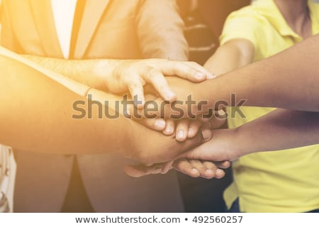 hands on top of each other symbolic picture stock photo © oly5