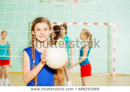 young girl holding volleyball stock photo © andreypopov