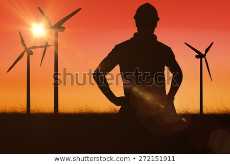 Wind turbines against red sky Stock photo © Onyshchenko