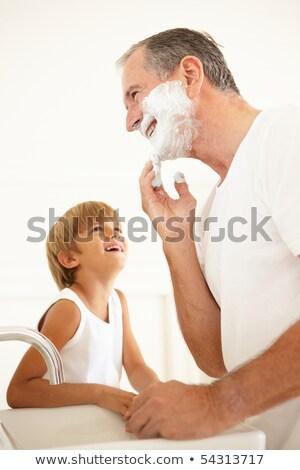 Neto assistindo avô banheiro espelho sorrir Foto stock © monkey_business