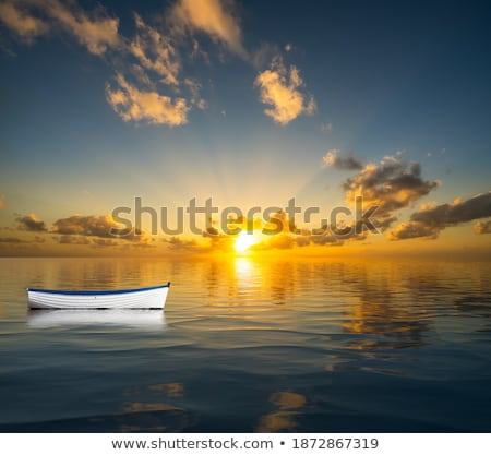Old rowing boat marooned at sea Stock photo © backyardproductions