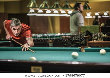 Stock photo: Close up shot of a snooker player taking shot