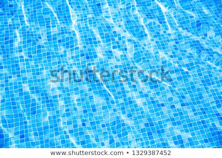 Stock fotó: Blue Ripped Water With Blue Mosaic In Swimming Pool