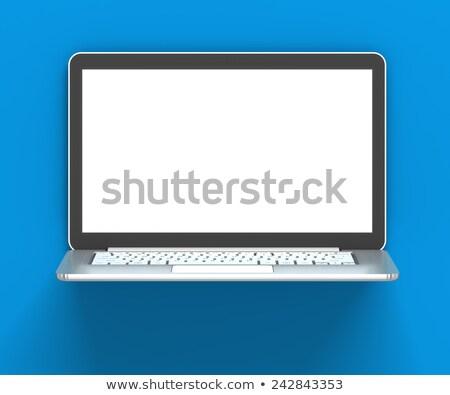 Laptop With Blank Screen Against Blue Wall 3d Render Stok fotoğraf © ymgerman
