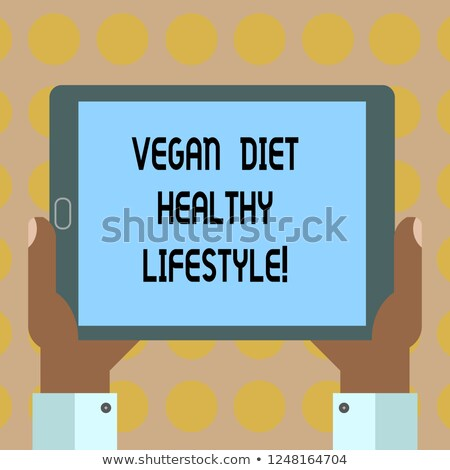 tablet with the word veganism on the display stock photo © zerbor