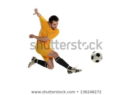 Football player in yellow jersey kicking Stock photo © wavebreak_media