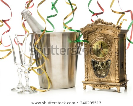 Two champagne glasses, bottle in cooler and clock Stock photo © karandaev