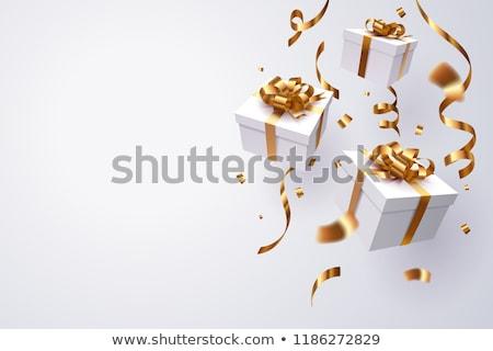 Geschenkdoos goud lint geïsoleerd witte Stockfoto © IngridsI