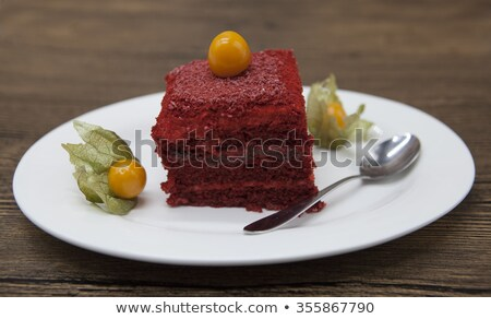 Red Velvet, fresh delicious diet cake with berry Physalis at Dukan Diet on a porcelain plate with a  Stock photo © mcherevan