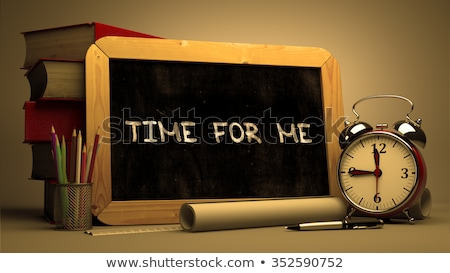 Handwritten Free Time on a Chalkboard. Stock photo © tashatuvango