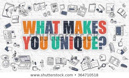 What Makes You Unique on White Brick Wall. Stock photo © tashatuvango