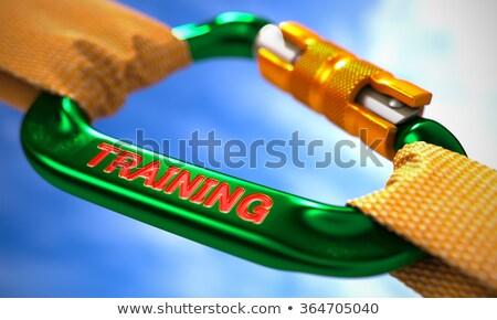Training on Green Carabiner between Orange Ropes. Stock photo © tashatuvango