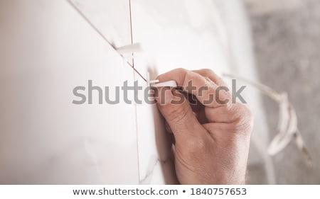 trabalhador · cerâmico · azulejos · parede · mão · trabalhar - foto stock © OleksandrO