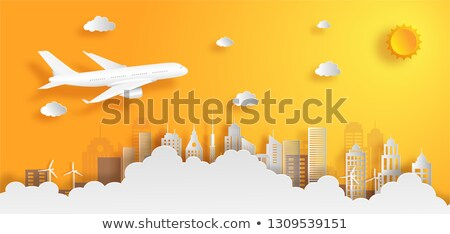 An airplane above the city Stock photo © bluering