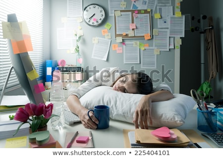 Tired woman at office desk sleeping with eyes closed Stock photo © deandrobot