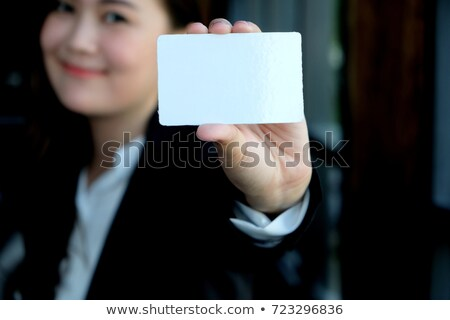 The businessman in black costume showing credit card or visiting card Stock photo © master1305