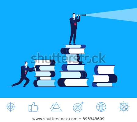 good businessman looking through binoculars stock photo © studiostoks